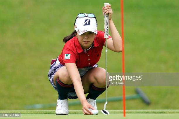 Kotone Hori of Japan puts her ball on the 16th green during the final round of the ECC Ladies Golf Tournament at Kitarokko Country Club on July 13...