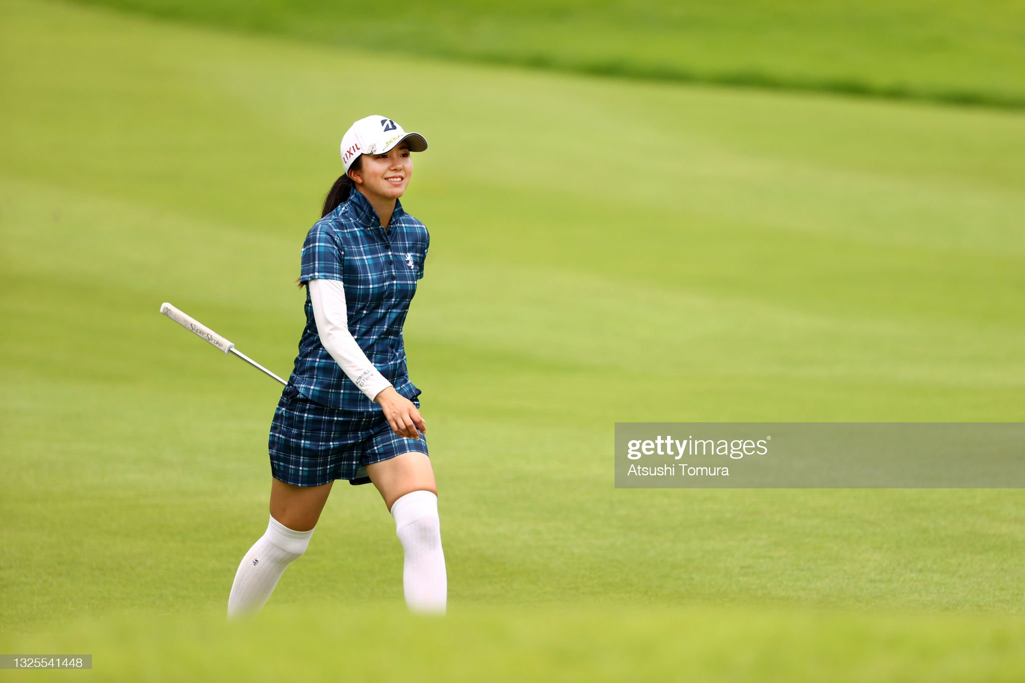 https://media.gettyimages.com/photos/kotone-hori-of-japan-smiles-on-the-8th-hole-during-the-third-round-of-picture-id1325541448?s=2048x2048