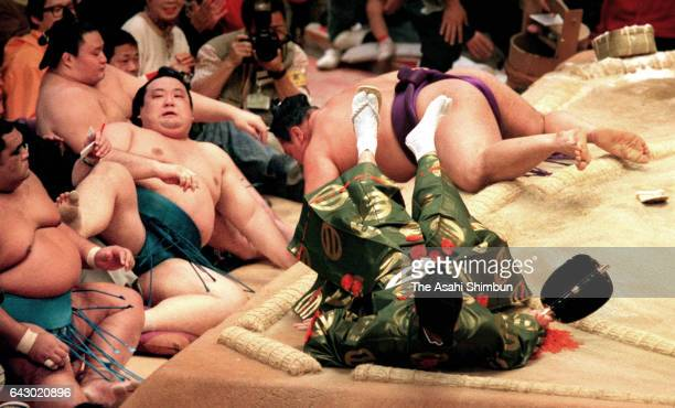 Kotonishiki pushes Takanonami to win the tournament on day fourteen of the Grand Sumo Kyushu Tournament at Fukuoka Convention Center on November 21...