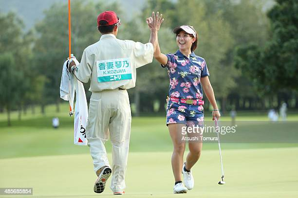 Kotono Kozuma of Japan celebrates after making her birdie putt on the 18th hole during the second round of the Nitori Ladies 2015 at the Otaru...