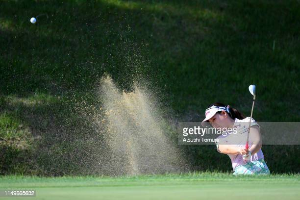 Kotono Kozuma of Japan hits out from a bunker on the 2nd hole during the first round of the HokennoMadoguchi Ladies at Fukuoka Country Club Wajiro...