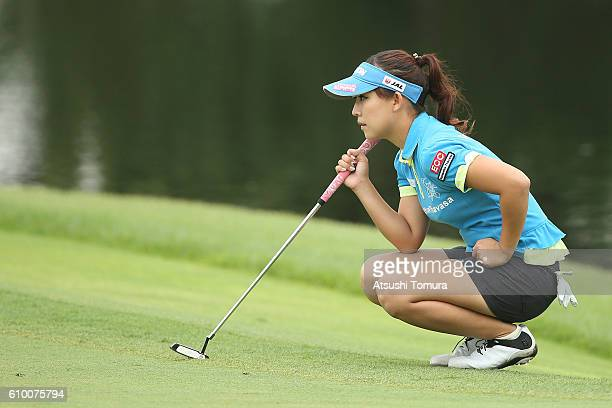 Kotono Kozuma of Japan lines up her birdie putt on the 15th green during the second round of the Miyagi TV Cup Dunlop Ladies Open 2016 at the Rifu...