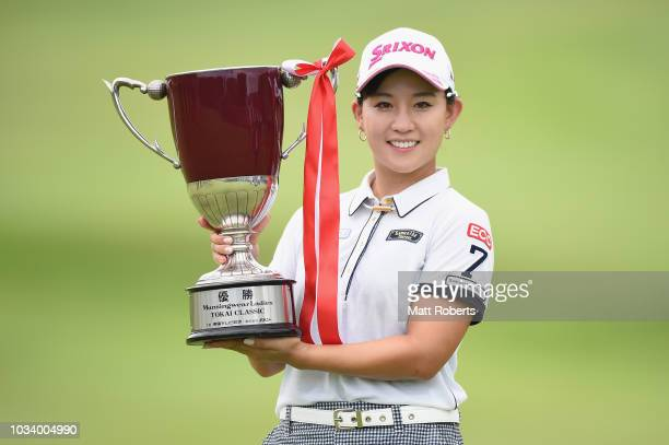 Kotono Kozuma of Japan pose with the winners trophy during the final round of the Munsingwear Ladies Tokai Classic at Shin Minami Aichi Country Club...