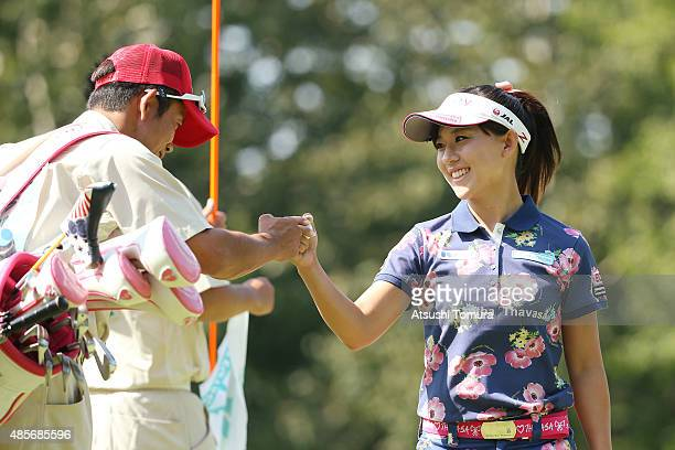 Kotono Kozuma of Japan smiles after making her birdie putt on the 5th hole during the second round of the Nitori Ladies 2015 at the Otaru Country...