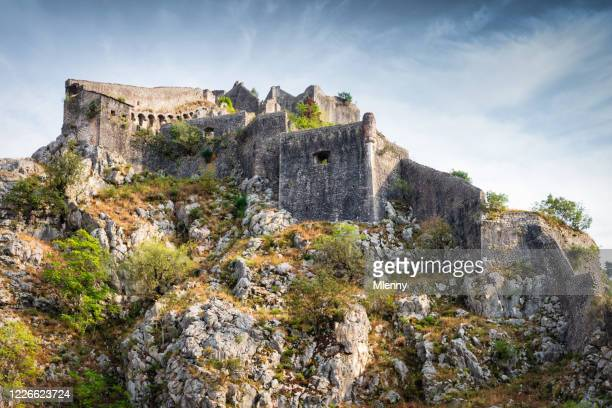 kotor fortress on mountain top st john fortress montenegro - kotor bay stock pictures, royalty-free photos & images