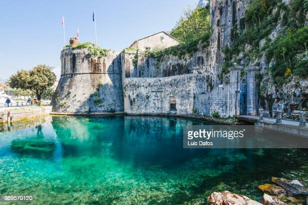 kotor gurdic gate and moat - montenegro stock pictures, royalty-free photos & images