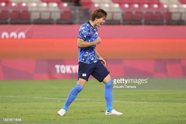 Kou Itakura of Team Japan celebrates scoring their team's second penalty in the penalty shoot out during the Men's Quarter Final match between Japan...