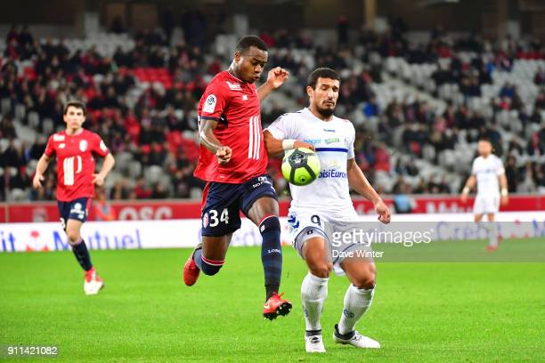 Kouadio Yves Dabila of Lille and Idriss Saadi of Strasbourg during the Ligue 1 match between Lille OSC and Strasbourg at Stade Pierre Mauroy on...