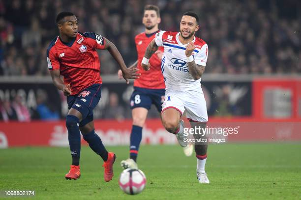Kouadio Yves Dabila of Lille, Memphis Depay of Olympique Lyon during the French League 1 match between Lille v Olympique Lyon at the Stade Pierre...