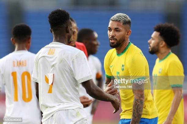 Kouadio-Yves Dabila of Team Ivory Coast interacts with Luiz Douglas of Team Brazil during the Men's First Round Group D match between Brazil and Cote...