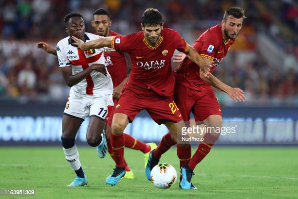 Kouakou Kouame of Genoa, Federico Fazio and Bryan Cristante of Roma during the Serie A match Roma v Genoa at the Olimpico Stadium in Rome, Italy on...