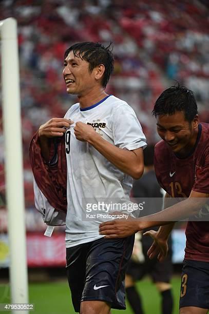 Kouji Nakata of Kashima Legends celebrates his goal with Atsushi Yanagisawa of Kashima Legends participate in the J League 2015 retirement game at...