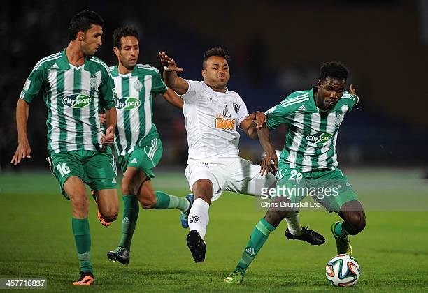 Kouko Guehi of Raja Casablanca fouls Fernandinho of Atletico Mineiro during the FIFA Club World Cup Semi Final match between Raja Casablanca and...