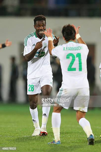Kouko Guehi of Raja Casablanca is congratulated by Adil Karrouchy after winning 21 during the FIFA Club World Cup Quarter Final match between Raja...