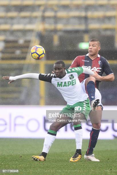 Kouma Babacar of US Sassuolo competes the ball with Sebastien De Maio of Bologna FC during the serie A match between Bologna FC and US Sassuolo at...