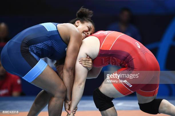 Koumba Larroque and Sara Dosho during the female 69kg wrestling competition during the Paris 2017 Women's World Championships at AccorHotels Arena on...