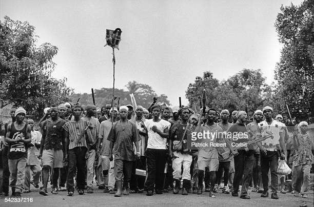 Koundou refugee camp Guinea Leader Aiah Sansie Kwigba in first row with some of his men