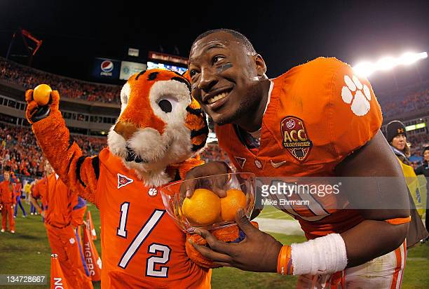 Kourtnei Brown of the Clemson Tigers celebrates winning the ACC Championship game against the Virginia Tech Hokies at Bank of America Stadium on...