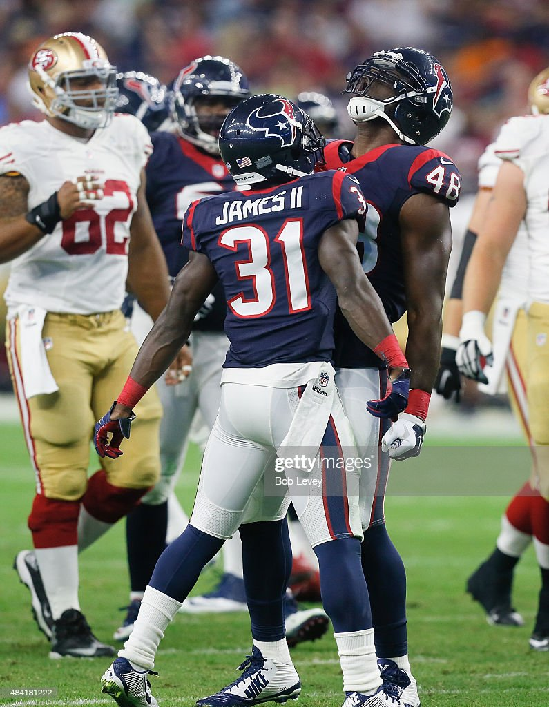 Kourtnei Brown #48 of the Houston Texans and Charles James #31 celebrates after a defensive stop against the San Francisco 49ers at Reliant Arena at Reliant Park on August 15, 2015 in Houston, Texas.