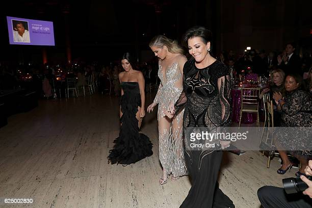 Kourtney and Khloe Kardashian and Kris Jenner approach the stage at the 2016 Angel Ball hosted by Gabrielle's Angel Foundation For Cancer Research on...