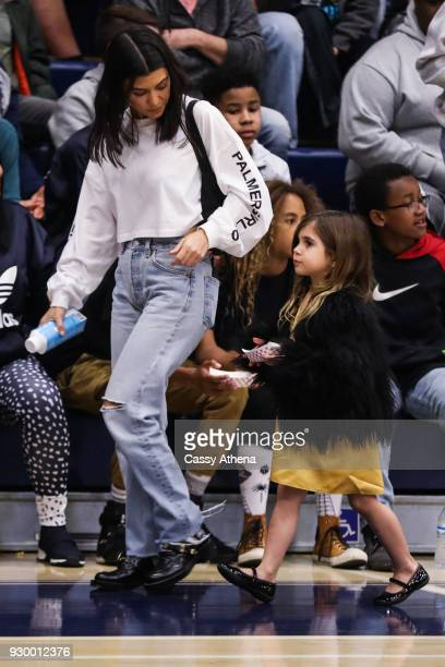 Kourtney Kardashian and daughter Penelope Disick attend as Sierra Canyon plays Foothills Christian for the CIF Open Division Playoffs on March 9 2018...