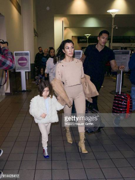 Kourtney Kardashian and daughter Penelope Scotland Disick are seen in Los Angeles International Airport on February 04 2018 in Los Angeles California