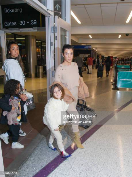 Kourtney Kardashian and her daughter Penelope are seen in Los Angeles International Airport on February 04 2018 in Los Angeles California