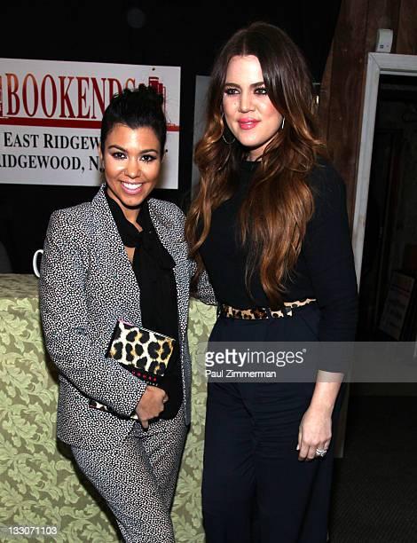 "Kourtney Kardashian and Khloe Kardashian promote the new book ""Dollhouse"" at Bookends Bookstore on November 16, 2011 in Ridgewood, New Jersey."
