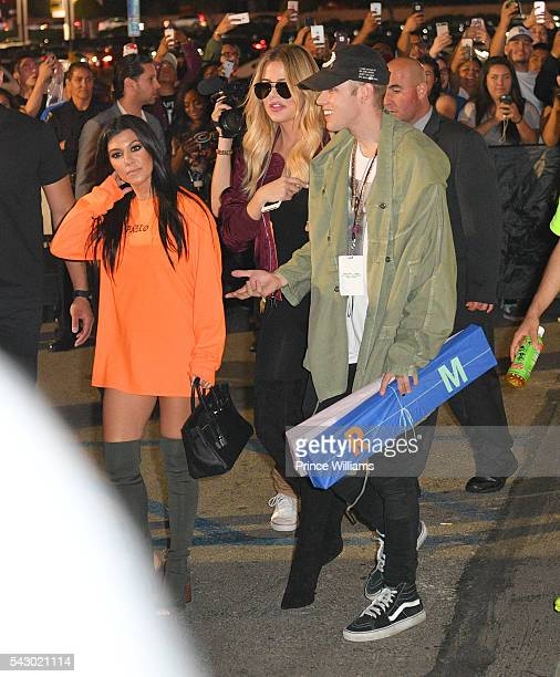 Kourtney Kardashian and Khloe Kardashian seen outside of the forum on June 24 2016 in Los Angeles California