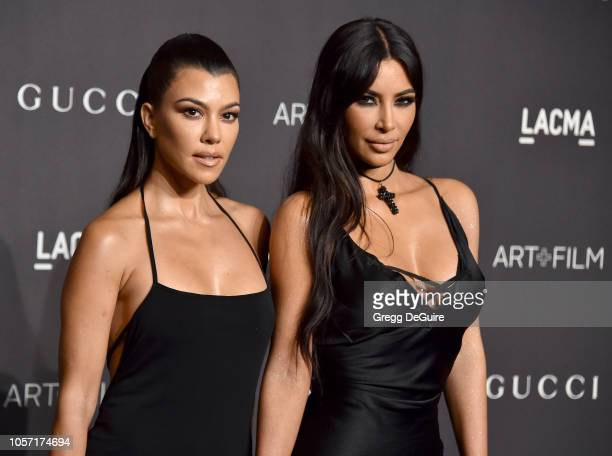 Kourtney Kardashian and Kim Kardashian arrive at the 2018 LACMA Art Film Gala at LACMA on November 3 2018 in Los Angeles California