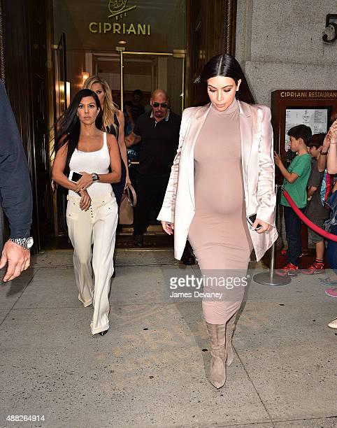 Kourtney Kardashian and Kim Kardashian leave Cipriani Downtown on September 14 2015 in New York City