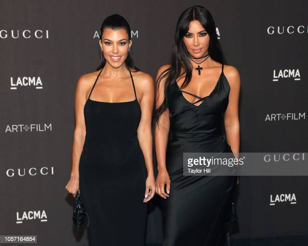 Kourtney Kardashian and Kim Kardashian West attend the 2018 LACMA ArtFilm Gala at LACMA on November 3 2018 in Los Angeles California