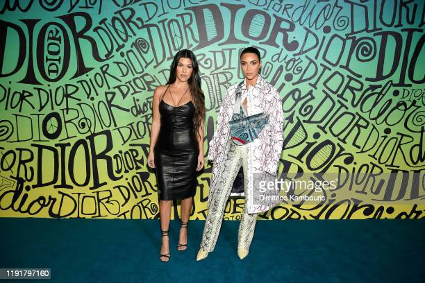 Kourtney Kardashian and Kim Kardashian West attend the Dior Men's Fall 2020 Runway Show on December 03 2019 in Miami Florida