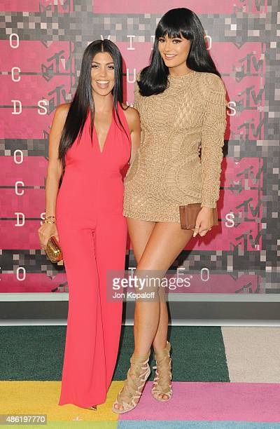Kourtney Kardashian and sister Kylie Jenner arrive at the 2015 MTV Video Music Awards at Microsoft Theater on August 30 2015 in Los Angeles California