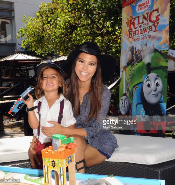 """Kourtney Kardashian and son Mason attend the """"Thomas & Friends: King of the Railway"""" blue carpet premiere at The Grove on September 15, 2013 in Los..."""