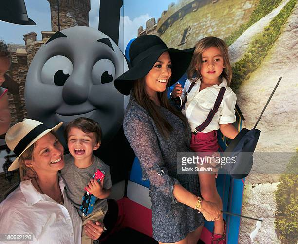 """Kourtney Kardashian and son Mason with guests attend the """"Thomas & Friends: King of the Railway"""" blue carpet premiere at The Grove on September 15,..."""