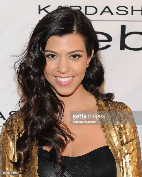 Kourtney Kardashian arrives at an instore appearance celebrating the 'Kardashian by bebe' holiday and resort collections at the bebe Beverly Center...