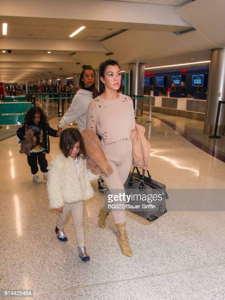 Kourtney Kardashian daughter Penelope and her niece North West are seen in Los Angeles International Airport on February 04 2018 in Los Angeles...