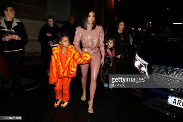 Kourtney Kardashian, daughter Penelope Disick, Kim Kardashian and daughter North West arrive at the Ferdi restaurant on March 01, 2020 in Paris,...