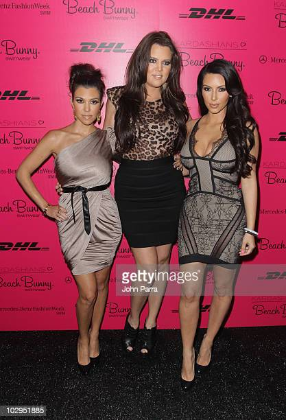 Kourtney Kardashian, Khloe Kardashian and Kim Kardashian attend the Beach Bunny Swimwear show during Mercedes-Benz Fashion Week Swim 2011 at Raleigh...