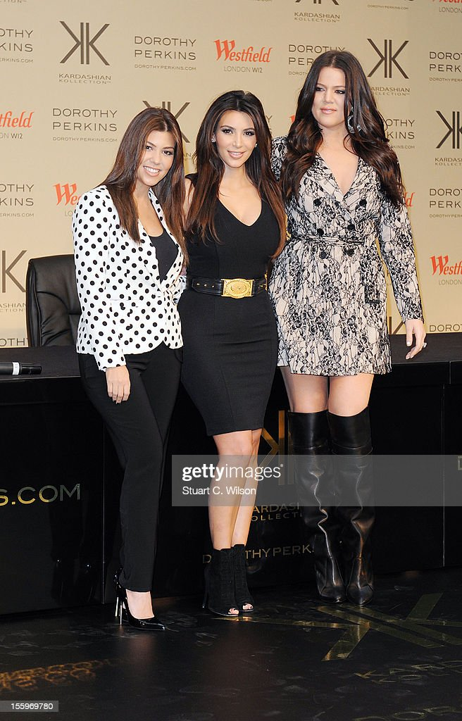 Kourtney Kardashian, Kim Kardashian and Khloe Kardashian Odom attend the photocall to launch the Kardashian Kollection for Dorothy Perkins at Westfield on November 10, 2012 in London, England.