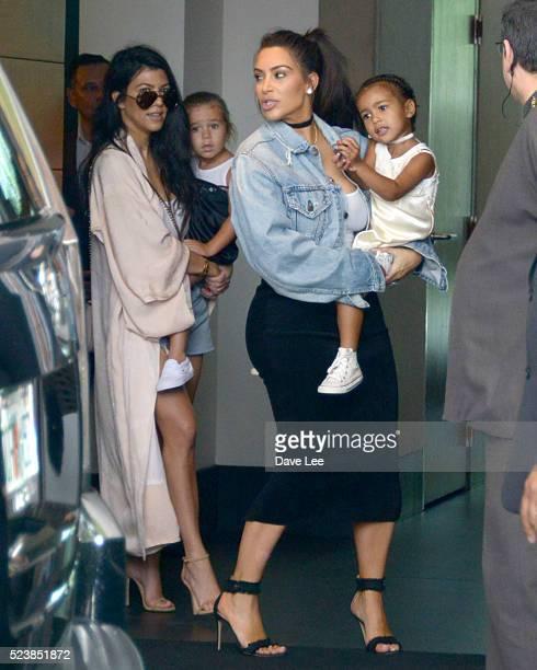 Kourtney Kardashian Penelope Disick Kim Kardashian and North West are seen on April 24 2016 in Miami Beach Florida
