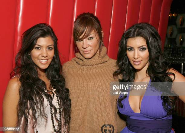 Kourtney Kardashian Robin Antin and Kim Kardashian pose for a photo at the Keeping Up With the Kardashians viewing party at Chapter 8 Restaurant on...