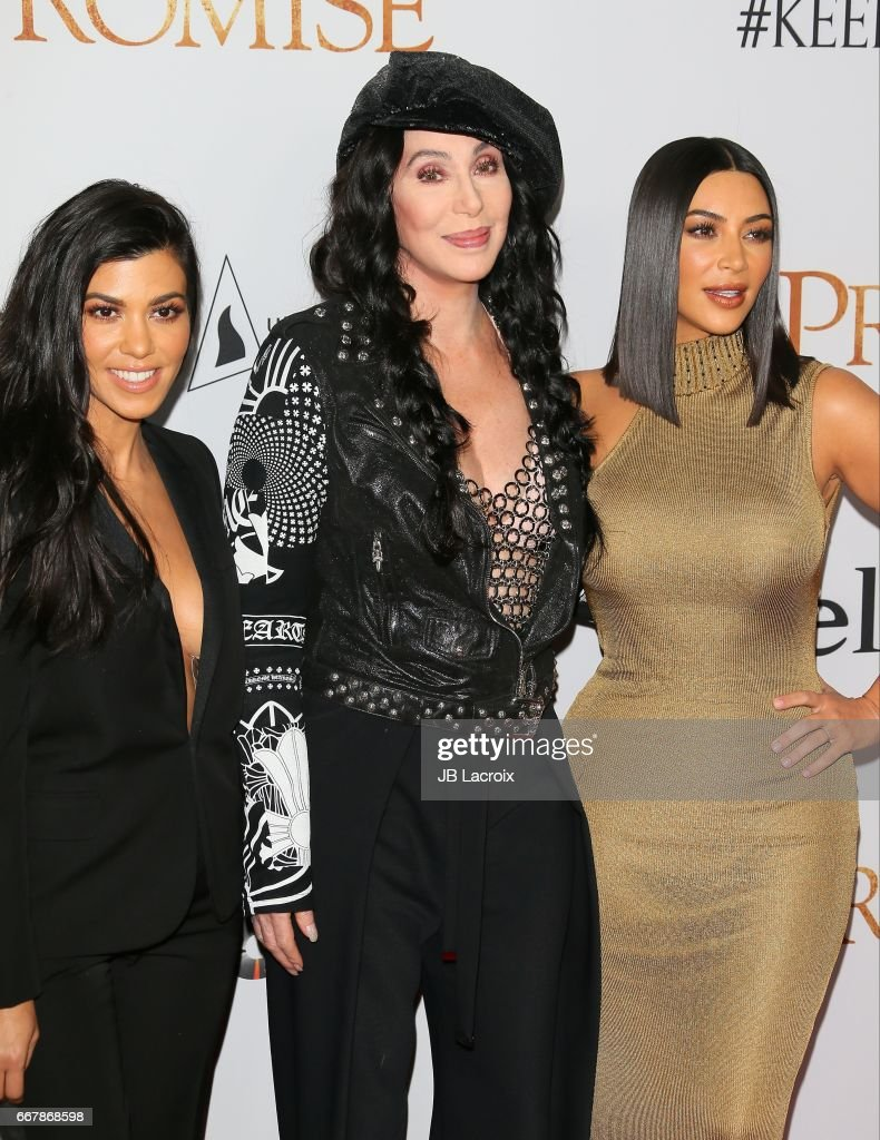 Kourtney Kardashian, Singer Cher and Kim Kardashian West attend the premiere of Open Road Films' 'The Promise' on April 12, 2017 in Hollywood, California.