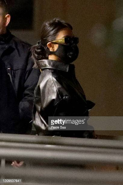Kourtney Kardashian wearing a mask is seen arriving at Le Bourget airport on February 29, 2020 in Paris, France.