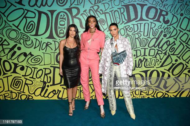 Kourtney Kardashian, Winnie Harlow and Kim Kardashian West attend the Dior Men's Fall 2020 Runway Show on December 03, 2019 in Miami, Florida.