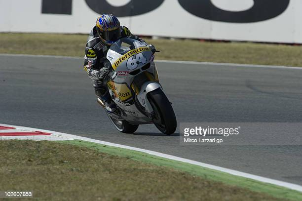 Kousuke Akiyoshi of Japan and Interwetten MotoGP Team rides down a straight during the qualifying practice session of MotoGP of Catalunya in...