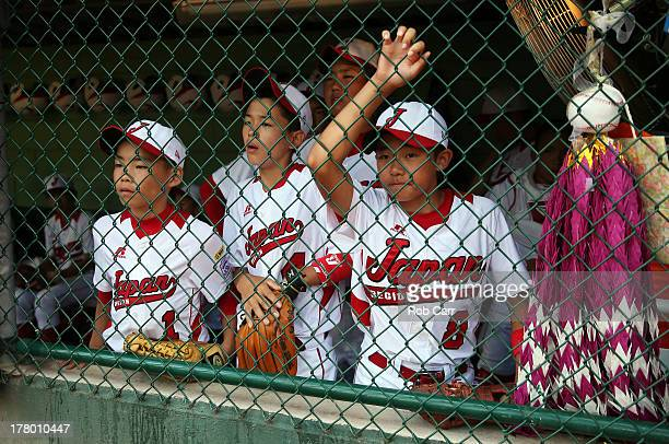 Kouyou Mizushima Dai Okada and Kensuke Tsuchida of the Tokyo Japan team look on from the dugout before the start of the Little League World Series...