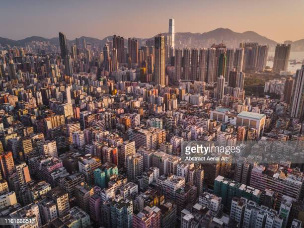 kowloon overview during golden hour taken by drone, hong kong - golden hour stock pictures, royalty-free photos & images