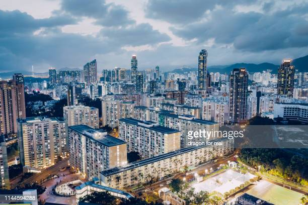 kowloon peninsula overview at night - kowloon stock pictures, royalty-free photos & images